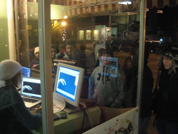 Christine Kuster drawing on Wacom Intuos4 Wireless for Shine projection exhibit at Muscatine Holiday Stroll